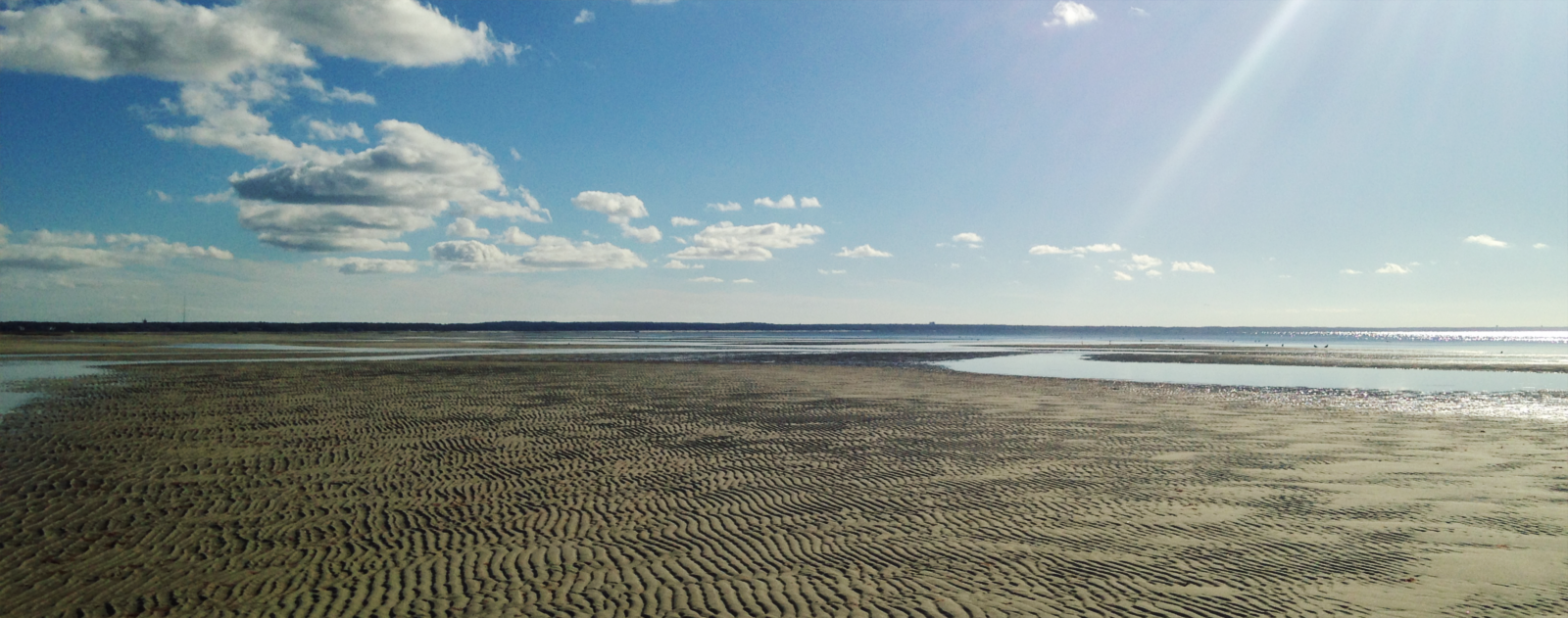 Sun, clouds and sand on Cape Cod Bay